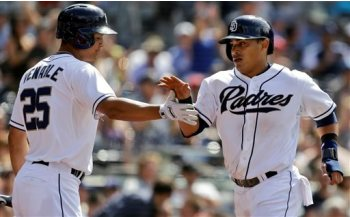 San Diego Padres' Everth Cabrera, right, is congratulated by teammate Will Venable after scoring in the ninth inning of their 4-1 loss to the Cincinnati Reds in a baseball game in San Diego, Wednesday, July 31, 2013. (AP Photo/Lenny Ignelzi)